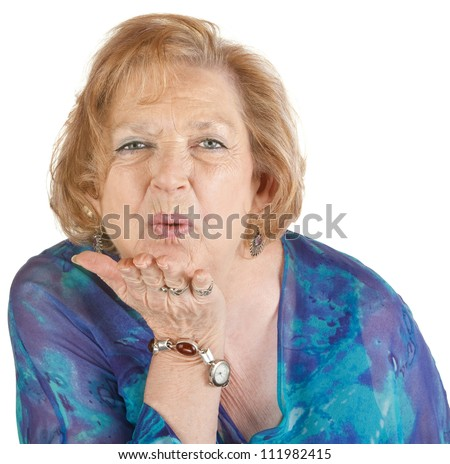 cute mature woman hand out blowing stock photo 111982415 - shutterstock