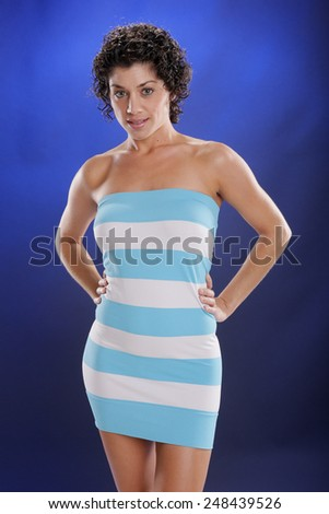 Cute mediterranean young woman in beach attire - stock photo