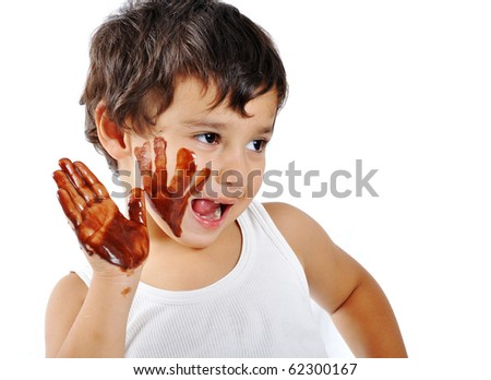 Cute messy kid isolated on white eating chocolate - stock photo