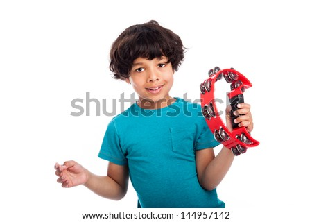 Cute mixed race kid playing a tambourine, isolated against white background. - stock photo