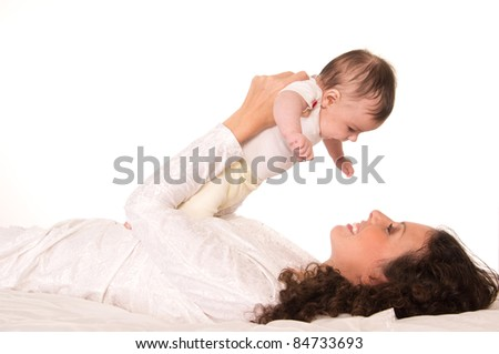 cute mom with her baby on a white