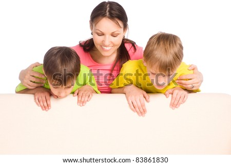 cute mom with her little boys on sofa