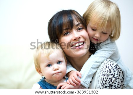 Cute mother and cute daughters. happiness - stock photo