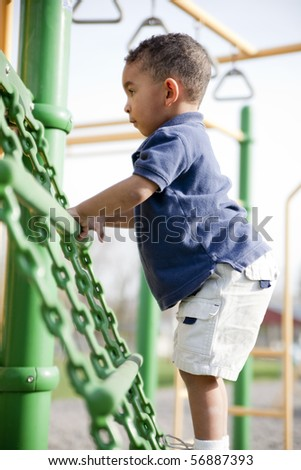 Cute multi-racial boy at the park playing