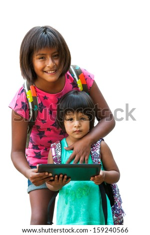 Cute native american schoolgirl showing tablet to youngster.Isolated on white. - stock photo