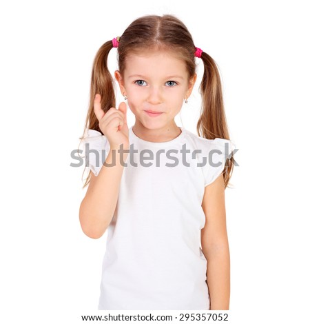 cute naughty little girl gesturing with her finger - stock photo