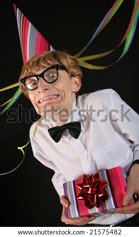 Cute nerd with a birthday surprise - stock photo
