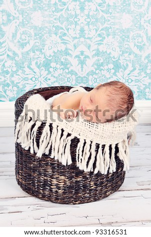 Cute newborn baby boy posing for camera - stock photo