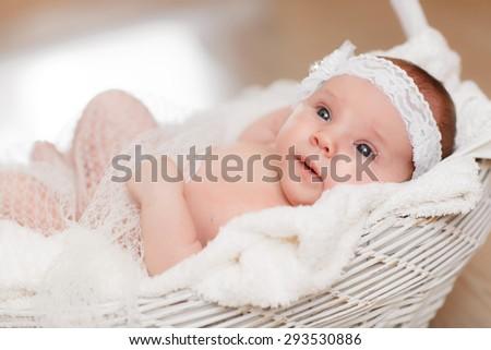 Cute newborn baby girl 1 month child sleeping in basket, adorable little girl new born kid portrait, happy baby portrait, beautiful little girl , soft tonality, series - stock photo