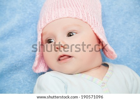 Cute newborn baby girl on the blue towel