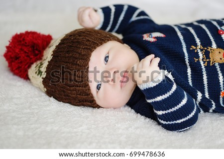 Cute newborn baby in warm wool knitted hat  and sweater