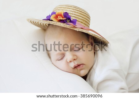 Cute newborn baby sleeps in a straw hat  - stock photo