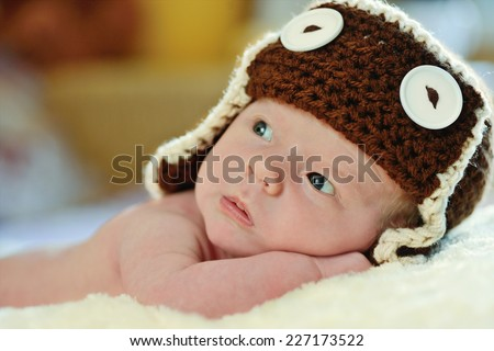 cute newborn wearing funny hat - stock photo