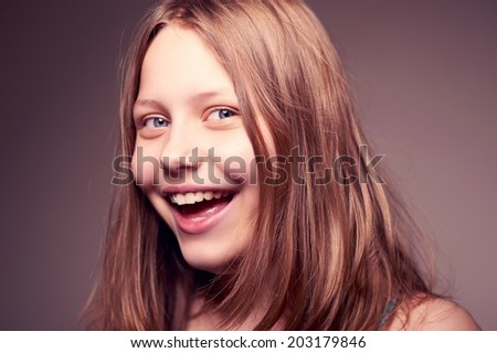 Cute nice happy teen girl looking at the camera and laughing - stock photo
