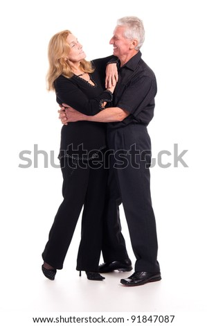 cute old couple posing on a white