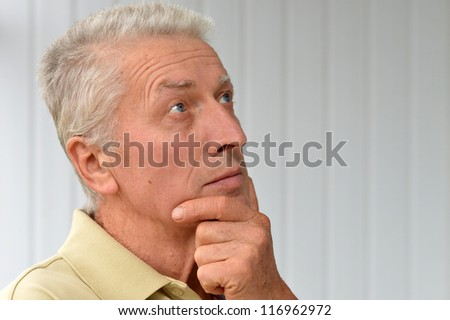 cute old man poses in a room