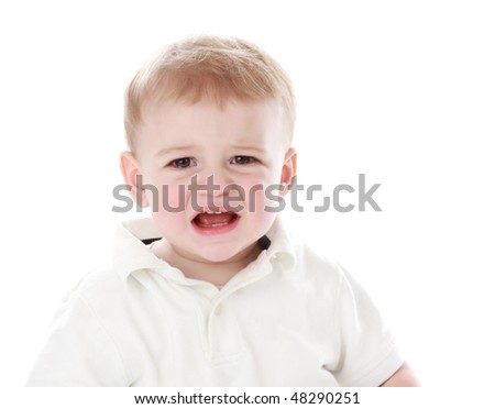 cute one year baby boy crying, isolated on white
