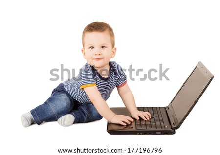 Cute one year old child with laptop isolated on white background - stock photo