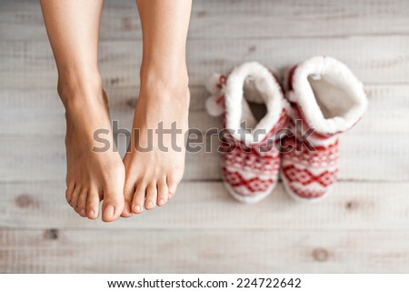 Cute photo of woman's feet with christmas slippers, top view point. Cozy, comfy, soft - stock photo