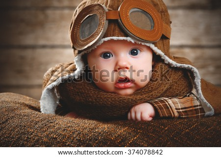 cute pilot aviator baby newborn in brown color - stock photo
