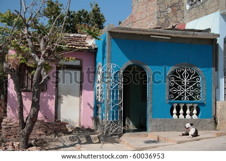 cute pink and blue homes in Trinidad - stock photo