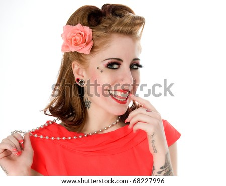Cute pinup model posing with flower in hair - stock photo