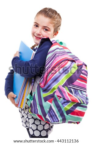 Cute preschool student girl holding notebooks and backpack on white background - stock photo