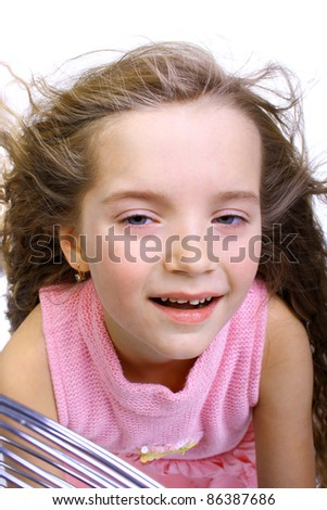 cute pretty little child with the blowing hair near the - stock photo
