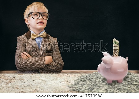 Cute pupil dressed up as teacher against blackboard on wall - stock photo