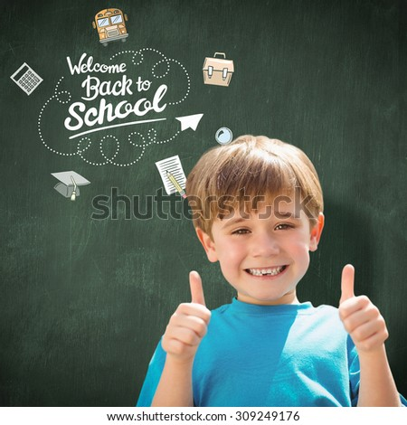 Cute pupil smiling at camera by the school bus against green chalkboard - stock photo