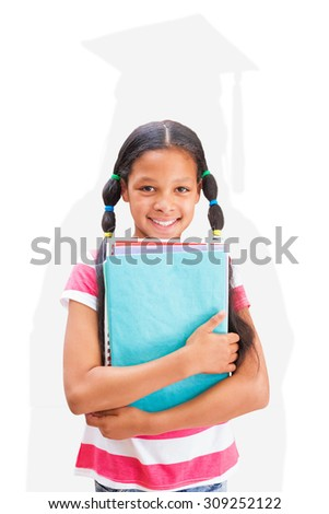 Cute pupil smiling at camera in library against silhouette of graduate - stock photo