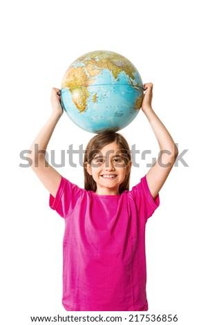 Cute pupil smiling holding globe on white background - stock photo