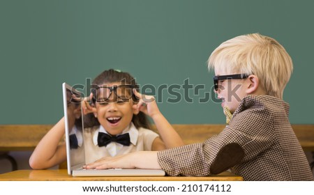 Cute pupils dressed up as teachers in classroom at the elementary school - stock photo