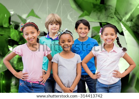 Cute pupils smiling at camera in classroom against angular design - stock photo