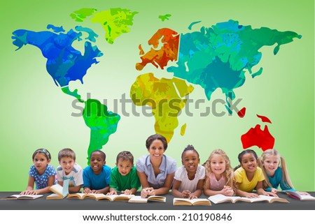 Cute pupils smiling at camera with teacher against green vignette with world map - stock photo