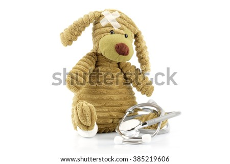 Cute puppy with medical device, pediatric or pet health conceptual - stock photo