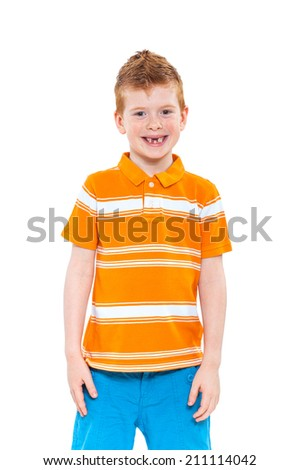 Cute red-haired boy against white background - stock photo