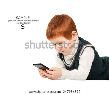 Cute red haired child poses with tablet pc and smart phone. Isolated. Place for your text - stock photo