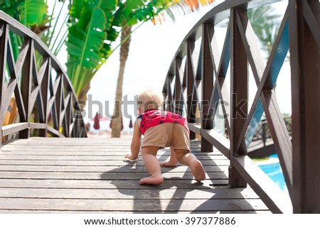 cute running and crawling baby  - stock photo