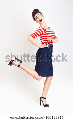 cute running woman with red lips in t-shirt and skirt - stock photo