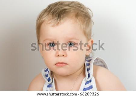 cute sad one year old boy studio portrait - stock photo