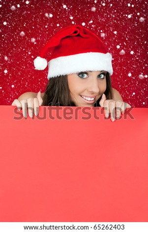 cute santa woman peeping over blank billboard - stock photo