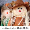 Cute scarecrow figurine used to celebrate the fall - stock photo