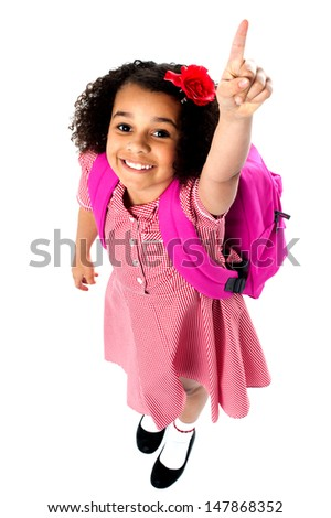 Cute school girl isolated over white background - stock photo
