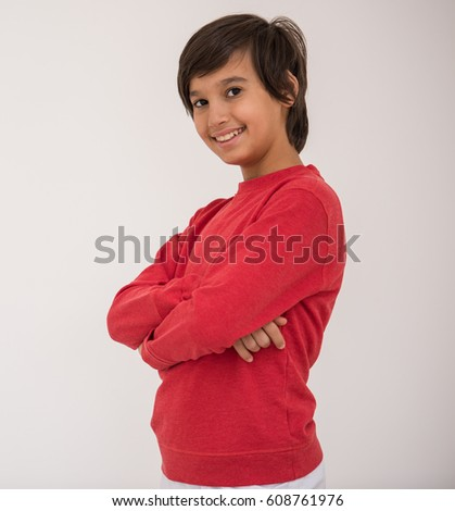 Cute school kid posing in studio with different facial expressions