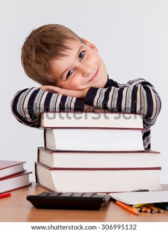 Cute schoolboy isolated on a white background - stock photo