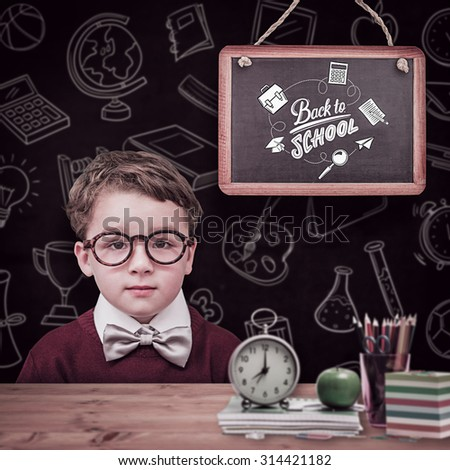 Cute schoolboy wearing reading glasses against bleached wooden planks background - stock photo