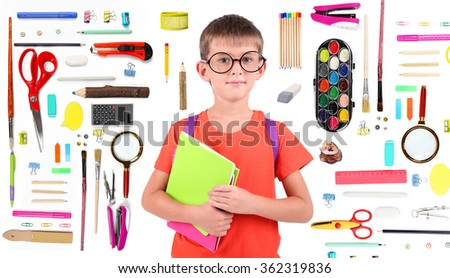Cute schoolboy with supplies, isolated on white - stock photo