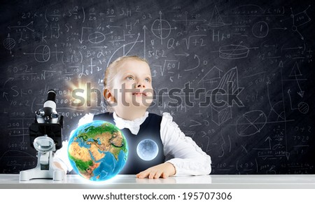Cute schoolgirl at school lesson using microscope. Elements of this image are furnished by NASA - stock photo