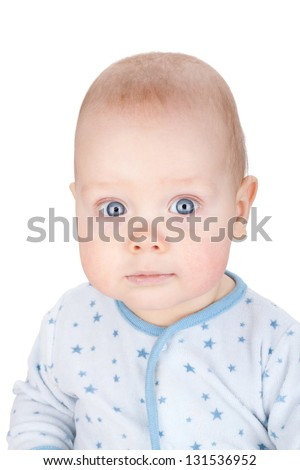 Cute serious baby. Isolated on white background